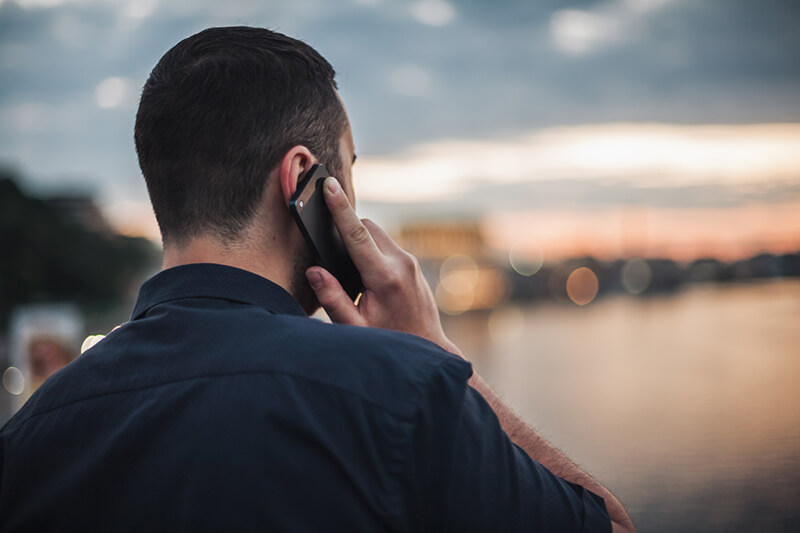 A man talking on his phone, possibly exposing him to the cell phone brain tumor link