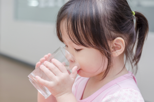 girl drinking water Lead Exposure