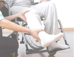 A patient in a wheelchair works with a physical therapist, who was paid with the help of a Long Island personal injury attorney