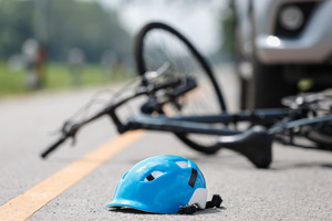 Cyclist Killed When Vehicle Collision Pushed Car onto Sidewalk