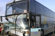 Charter Bus Hits Overpass Injuring Dozens