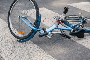 Bicycle Rider Dies from Severe Head Trauma after Being Hit by an SUV