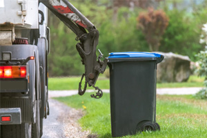 Garbage Truck Overturns and Injures Three in Holbrook, NY