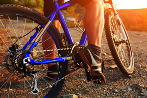 Female bicycle rider clinging to life after collision