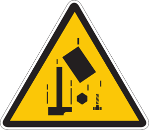 A caution sign depicting falling construction tools, warning of the risk of injury