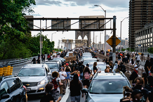 Furious suv driver strikes a group of protestors in brooklyn
